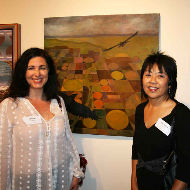 Marie Cameron and Patricia Oji with her painting Two Spirits Soaring Scapes PAL - photo Jorge Castrillo