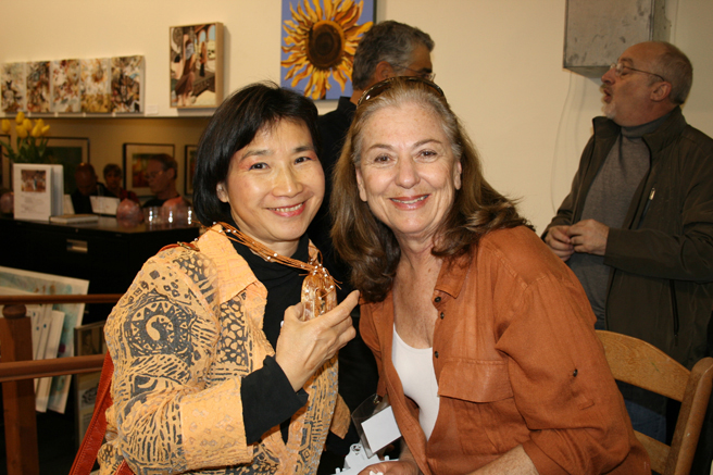 Painter Mei-Ying Dell'Aquila tries on jeweler Lenore Cymes's Necklace