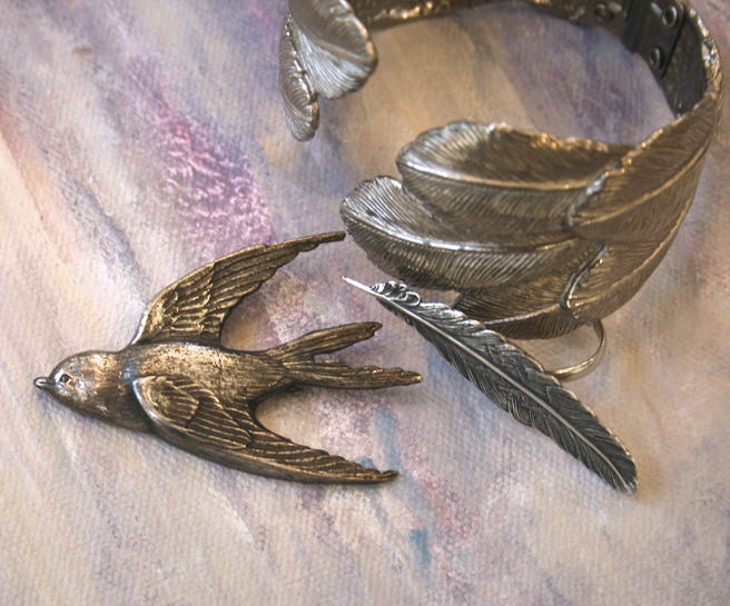 Charming swallow, feather ring and feather cuff.