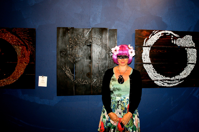 Art Party 2014 - Marie Cameron in front of Kebe Konte's rings of Fire -photo by Holly Van Hart